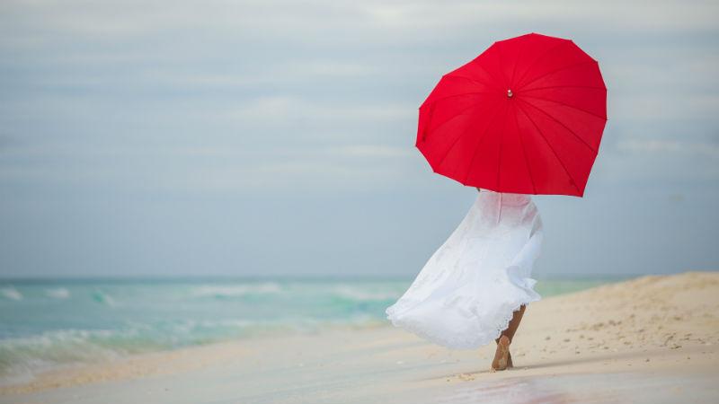 Caribbean storm on beach with bride