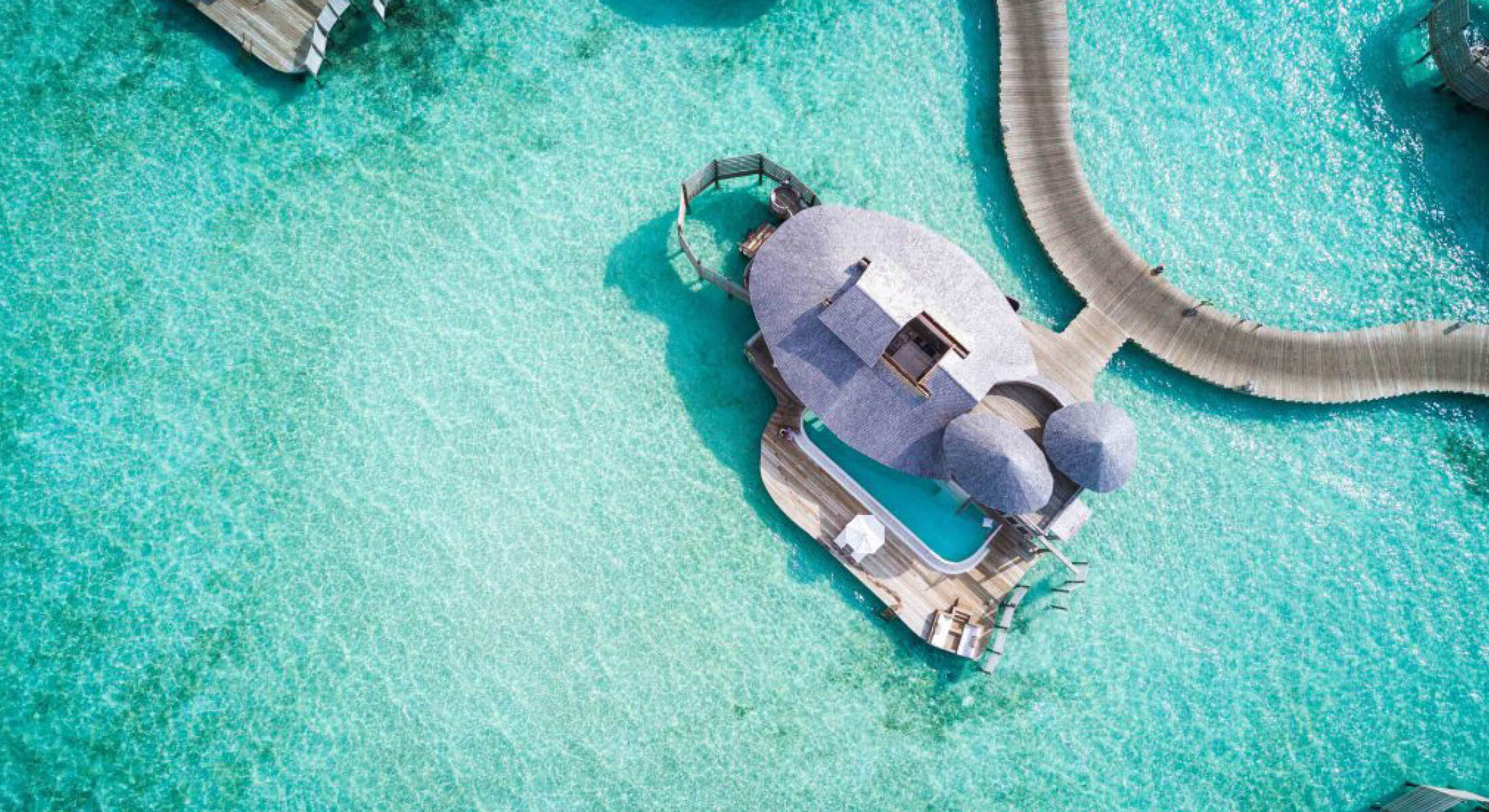 Aerial view of overwater villas in the Maldives on your next luxury holiday