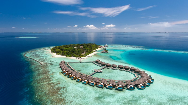 Aerial view of the water villas at Baros in the Maldives