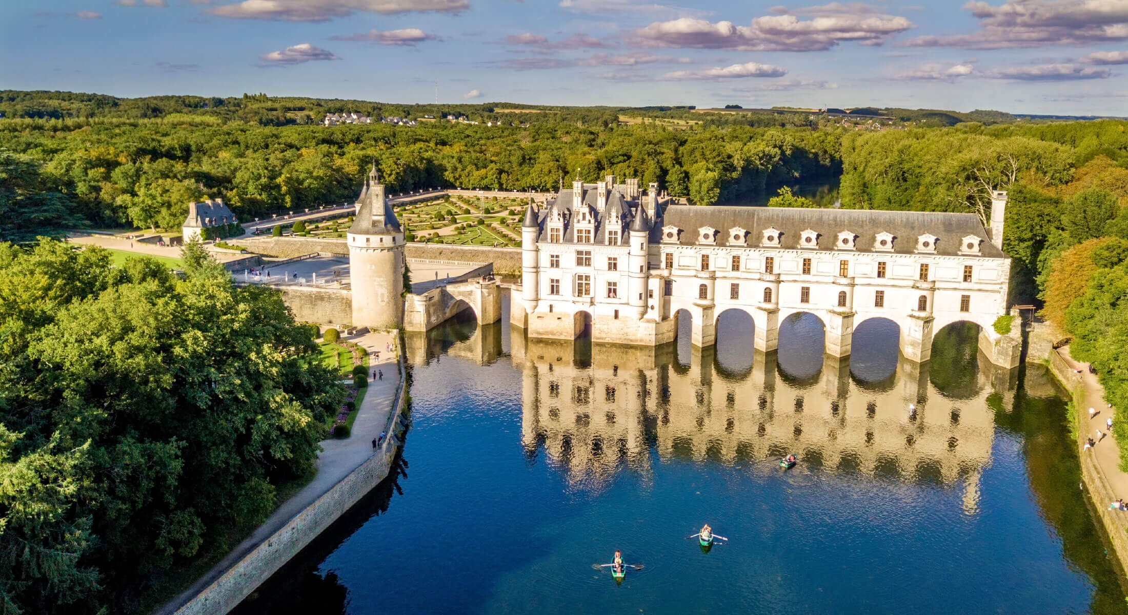 Aerial view of a European chateau over a river