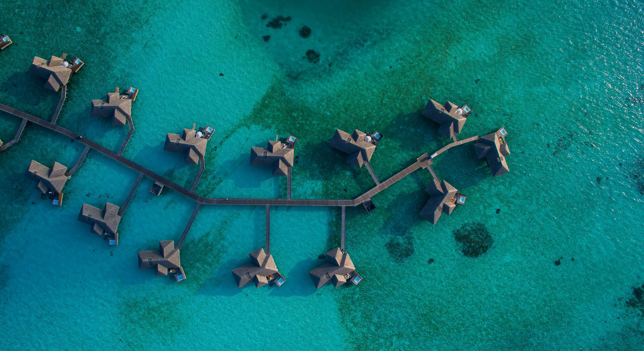 Aerial view of overwater villas in the Maldives