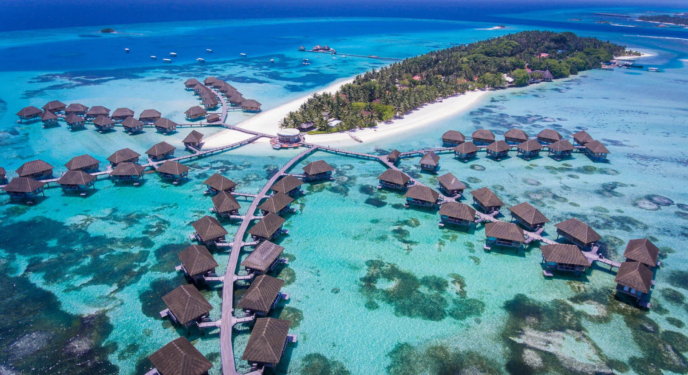Overwater villas on an island resort in the Indian Ocean