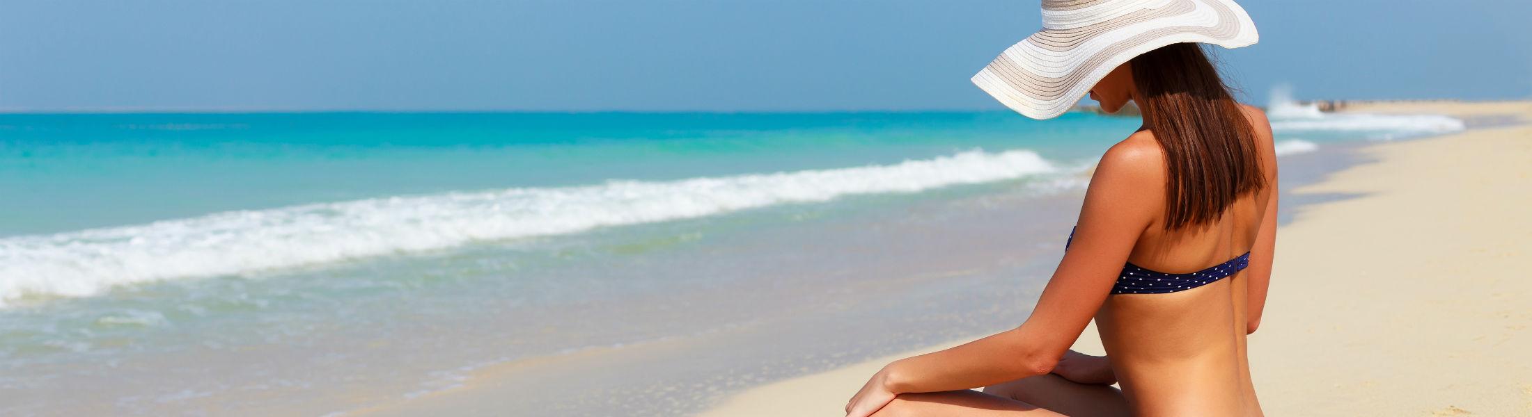 Dubai - Woman on beach relaxing