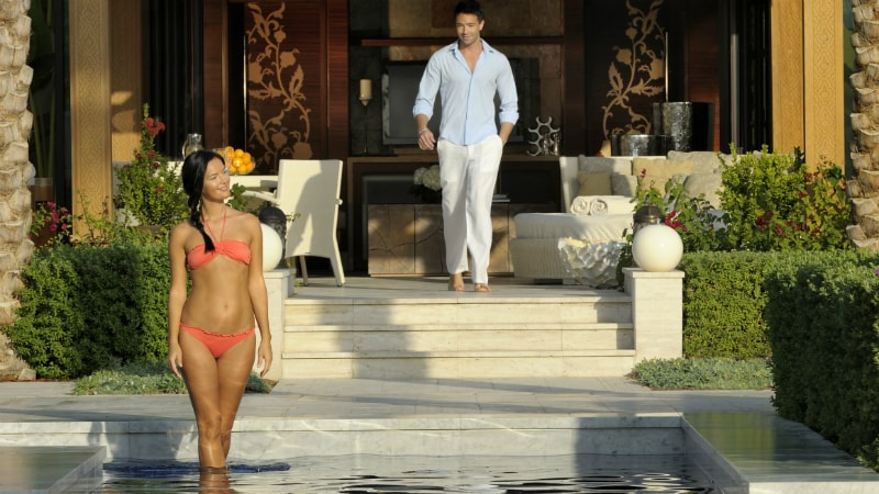 Couple by the pool at One&Only The Palm Dubai