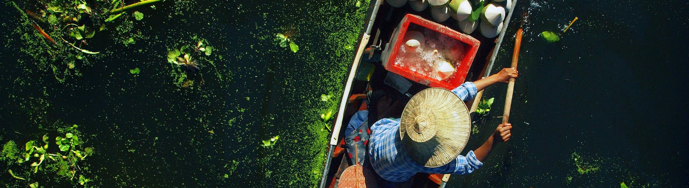 Seller on boat floating market Thailand