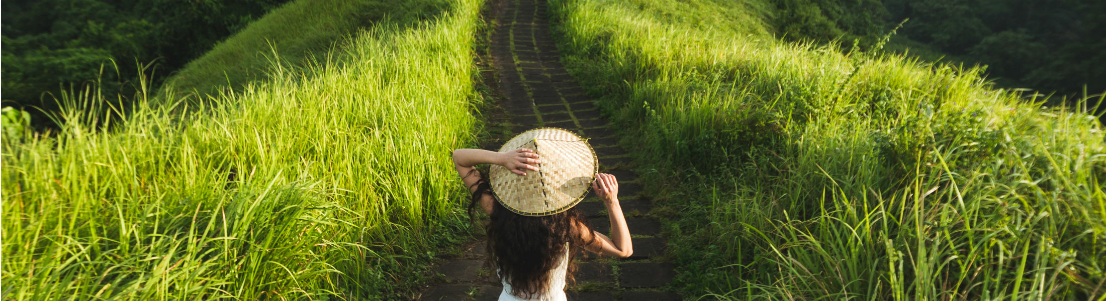 Woman walking through rice fields in Bali