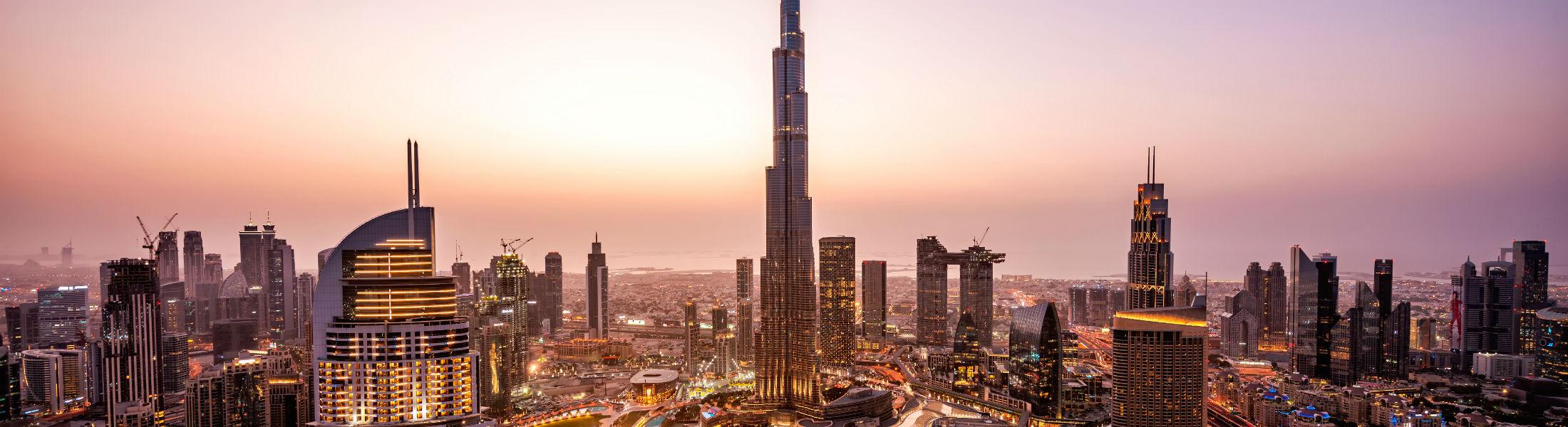 Dubai - Burj Khalifa and city at dusk
