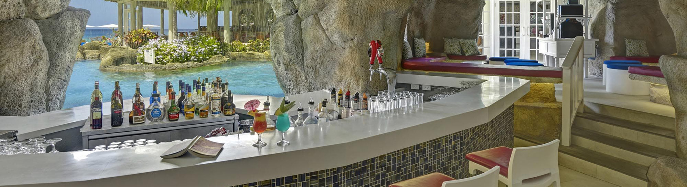 A bar inside a cave at Crystal Cove by Elegant Hotels