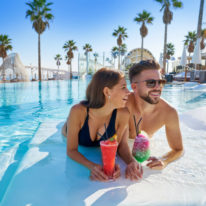 Couple at pool with drinks