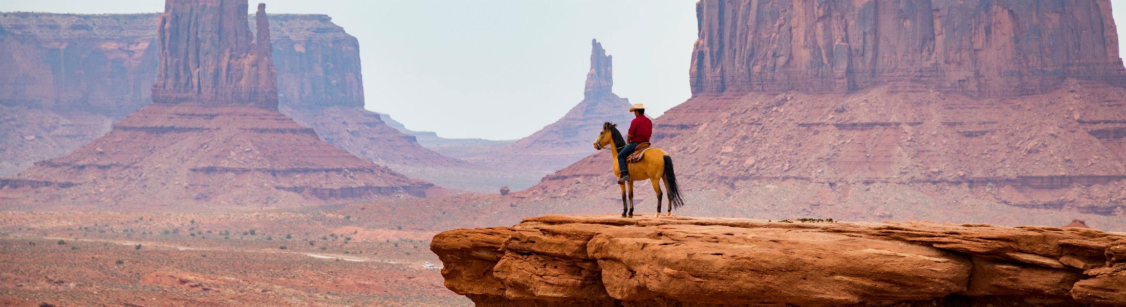 Cowboy looking at the horizon Monument Valley Navajo Tribal Par