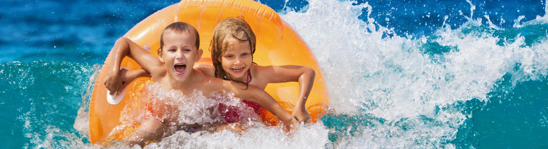 Happy kids having fun in sea