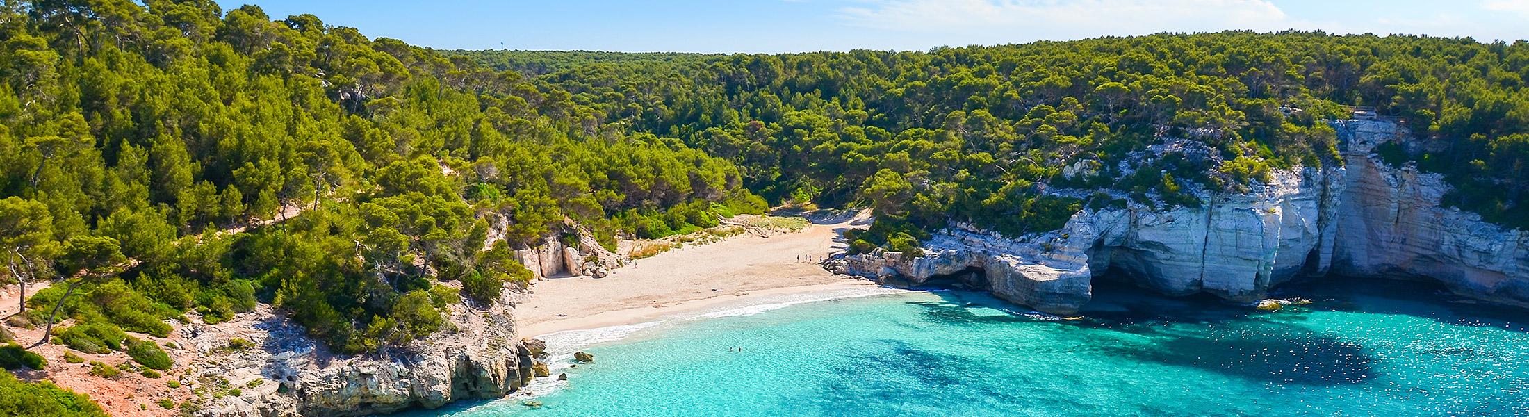 beach in a rocky cove in Menorca Spain in Europe