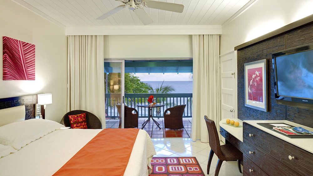 Bedroom overlooking the ocean at Crystal Cove by Elegant Hotels