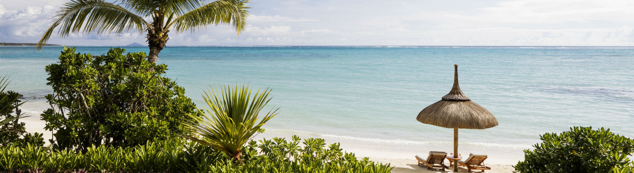 One&Only Le Saint Geran, Mauritius - beach with parasol