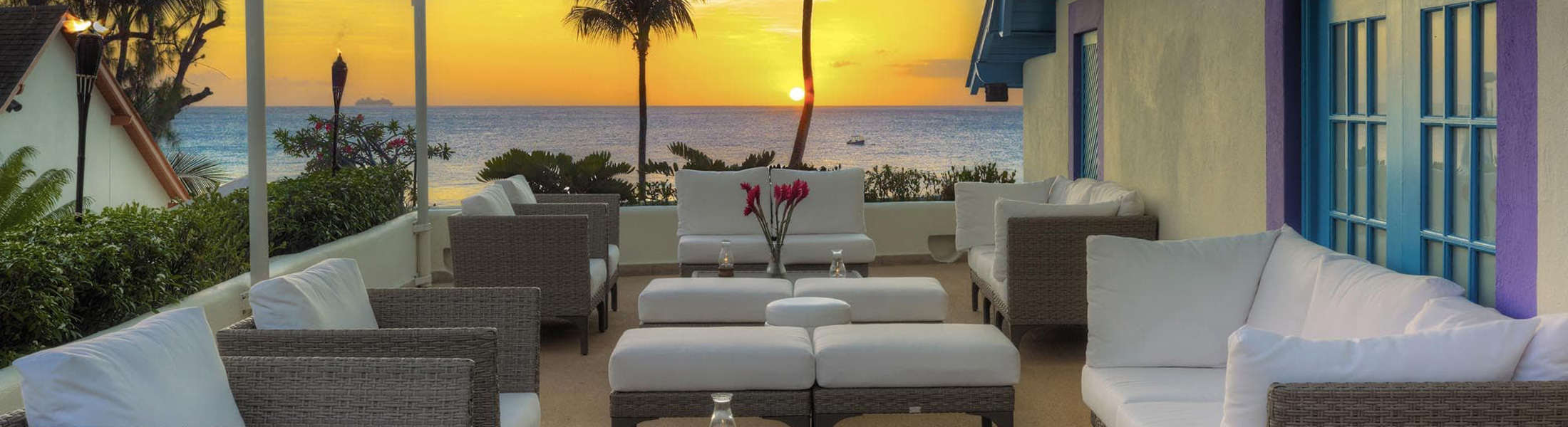 Outdoor dining restaurant at sunset at Crystal Cove by Elegant Hotels