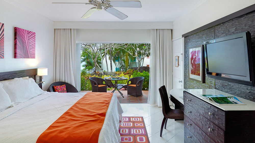 Bedroom with view over the pool at Crystal Cove by Elegant Hotels