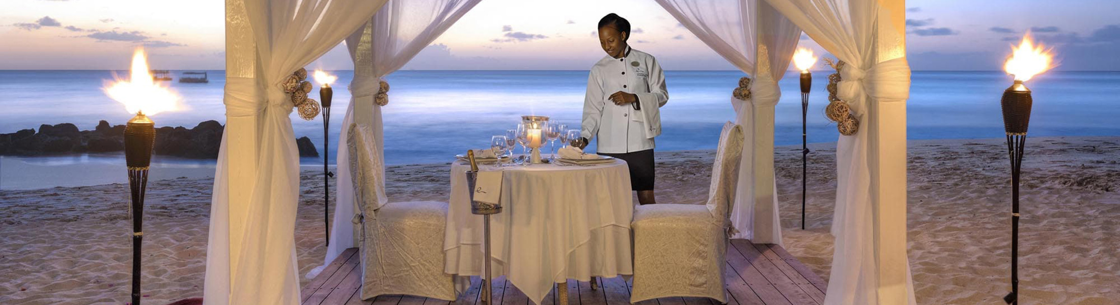 Private Dining on the beach at Crystal Cove by Elegant Hotels
