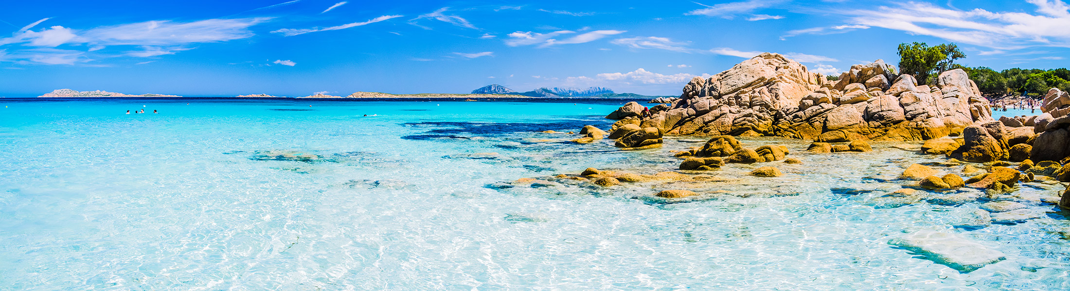 White beach, blue water and rocky coast in Sardinia Italy in Europe