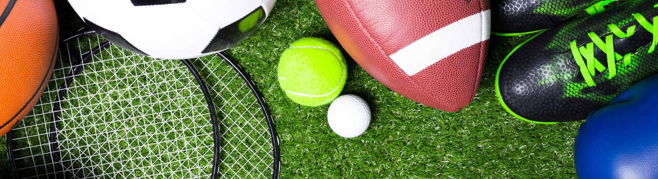 A selection of sporting equipment on grass