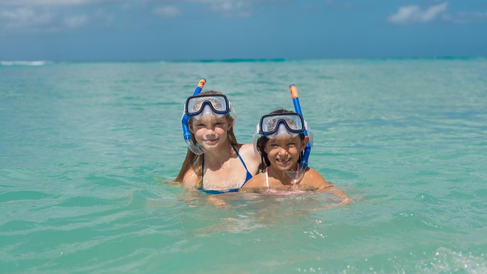 Children snorkelling at Crystal Cove by Elegant Hotels