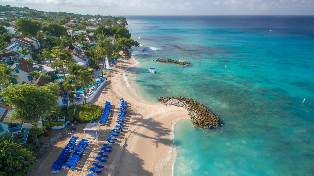 Aerial view of the beach at Crystal Cove by Elegant Resorts