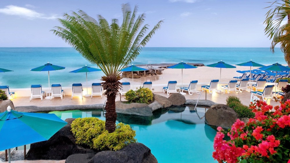 Sun Loungers around the pool and overlooking the beach at Crystal Cove by Elegant Hotels
