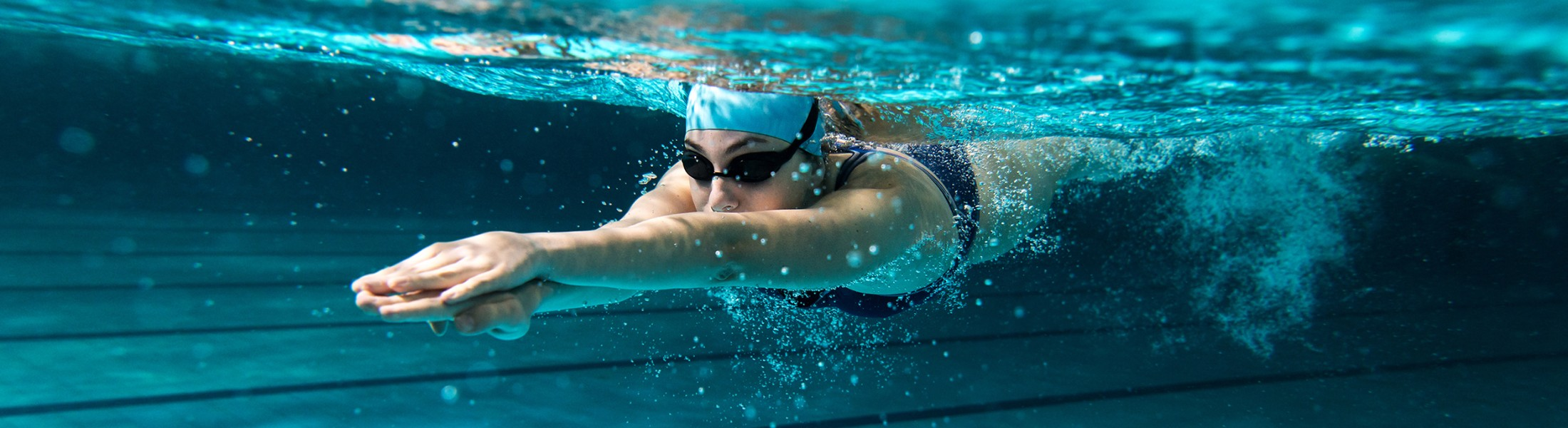 Woman diving underwater in a swimming pool