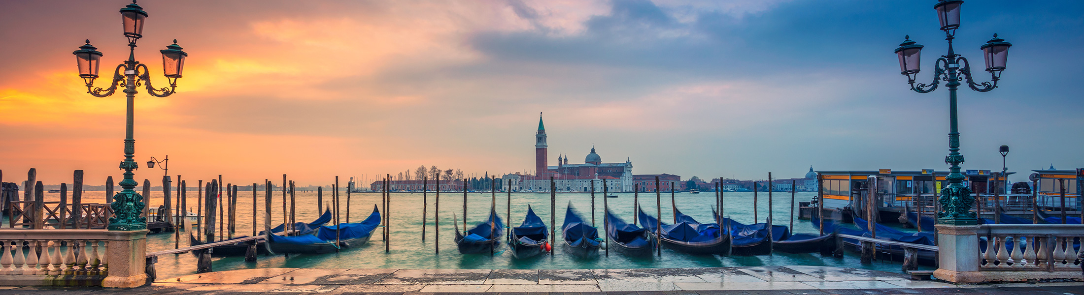 Gondolas at Sunset in Venice Italy in Europe