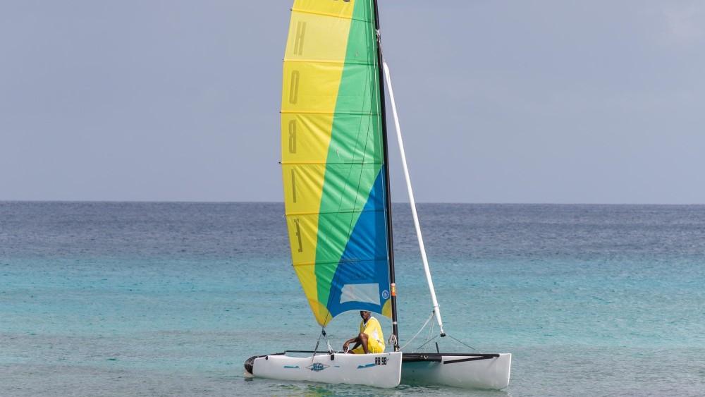 Barbados man sailing at Crystal Cove by Elegant Hotels