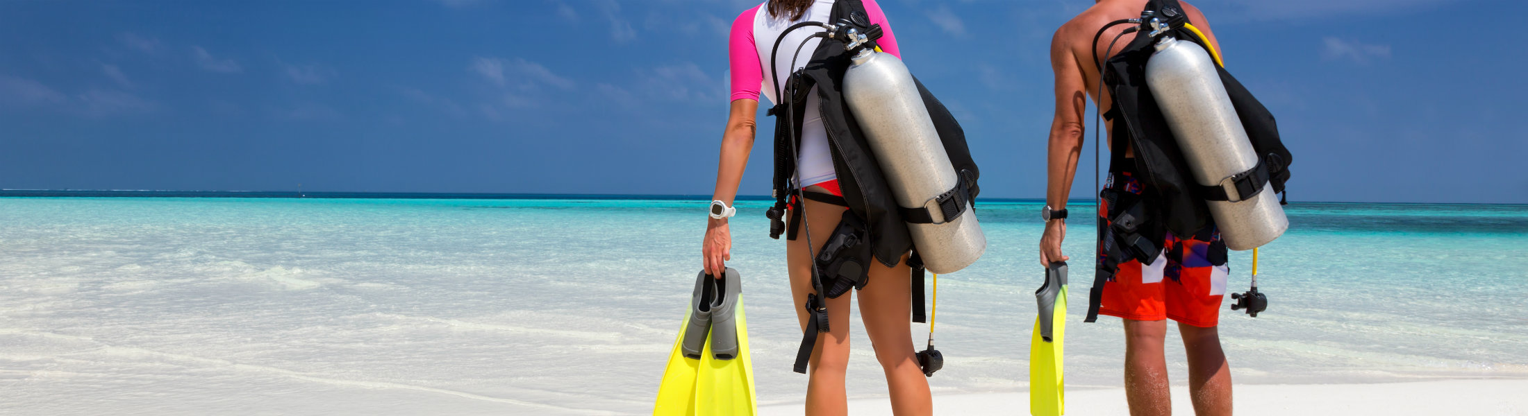 Young couple in scuba diving