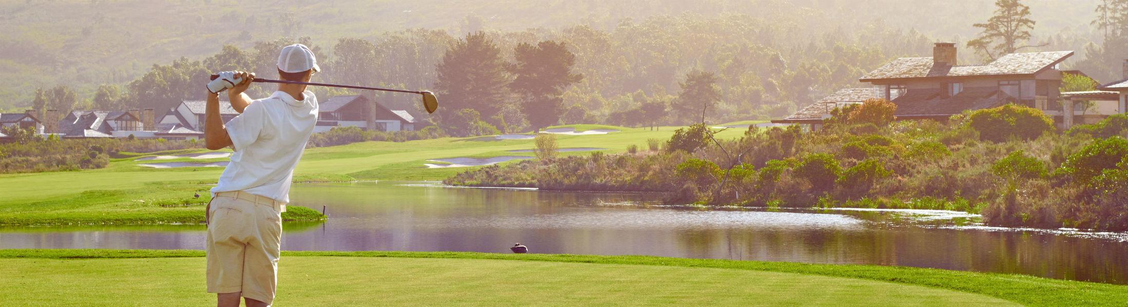 golf shot with club on summer