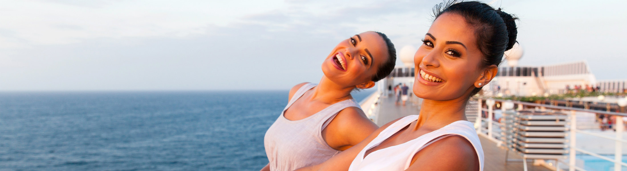 two women having fun on cruise ship
