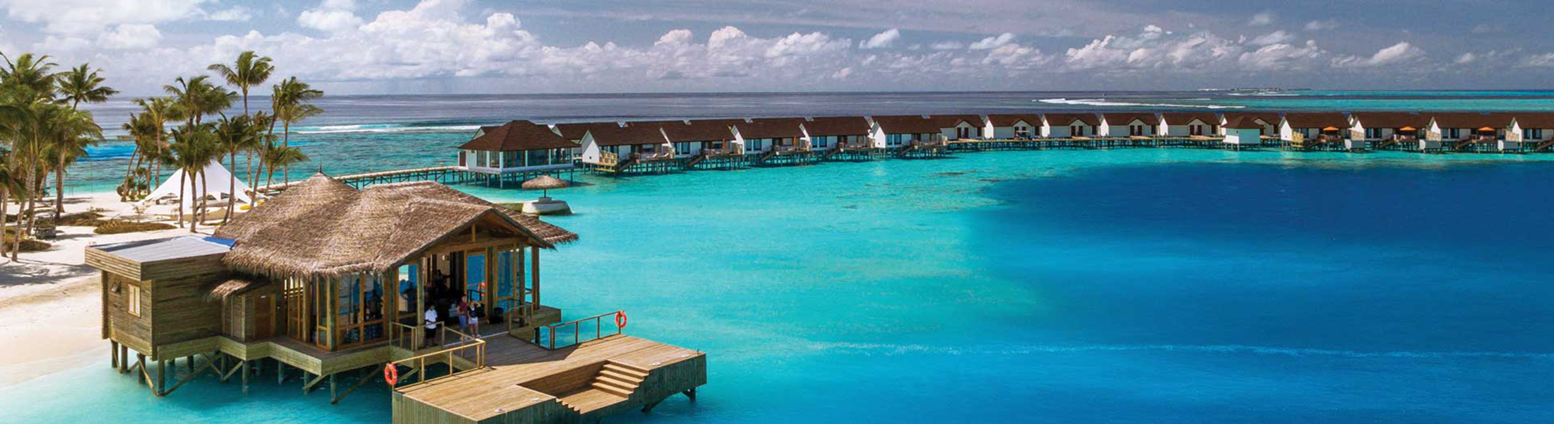 Arrival jetty and water villas at Oblu Select at Sangeli