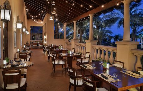 Outdoor dining in Blue Jade Restaurant at Ritz-Carlton Dubai at night