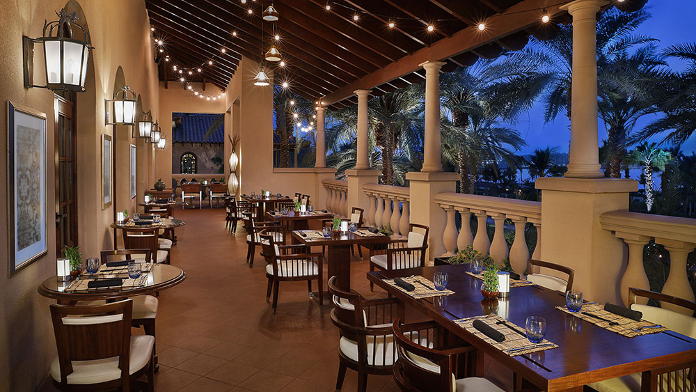 Outdoor dining in Blue Jade Restaurant at Ritz-Carlton Dubai at night