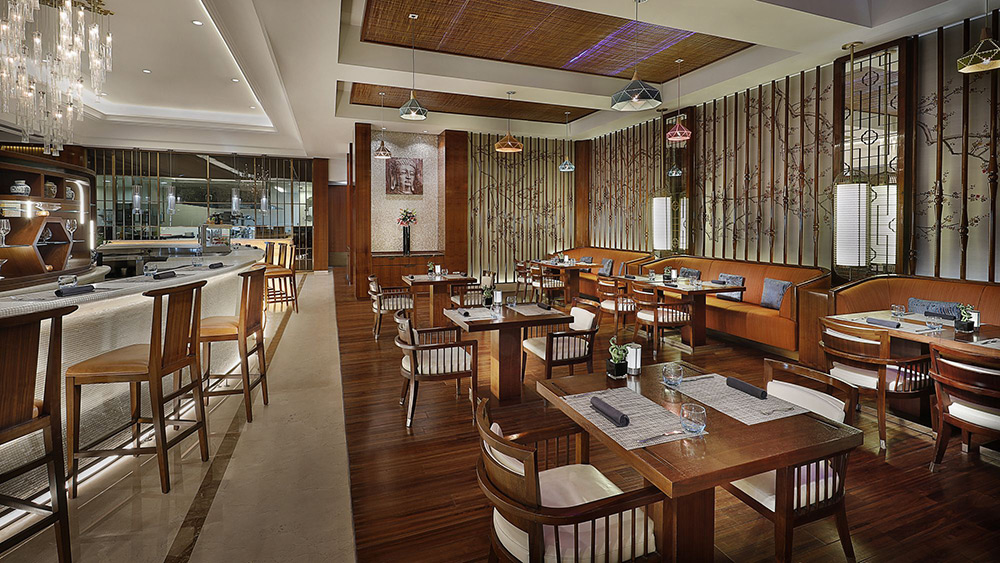 Indoor seating at Blue Jade Restaurant at Ritz-Carlton Dubai