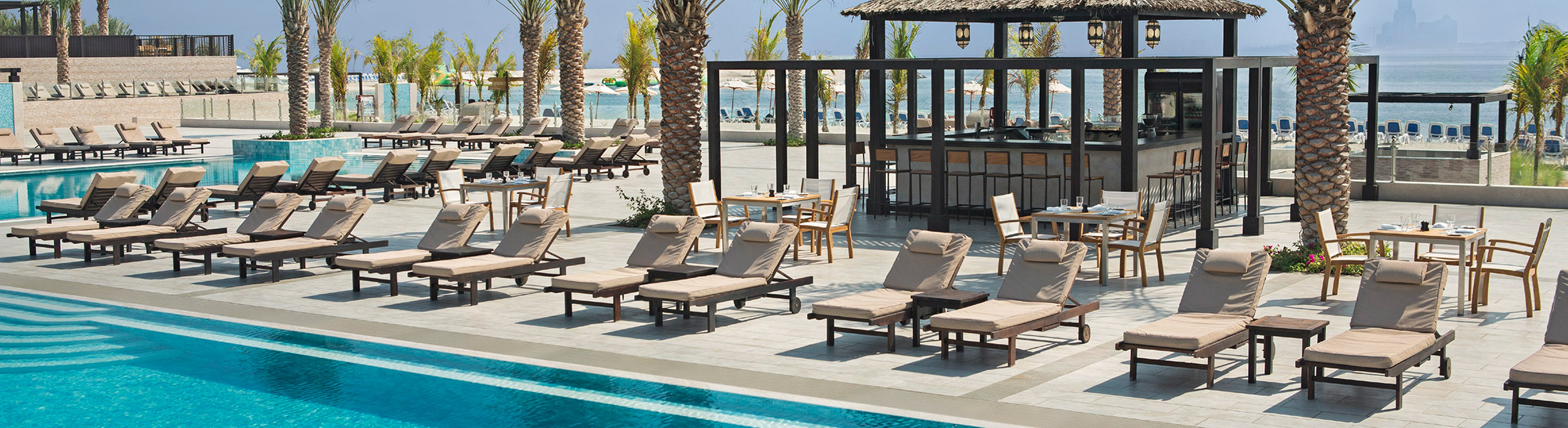 Sun lounges at the Boardwalk Bar at DoubleTree by Hilton Marjan Island