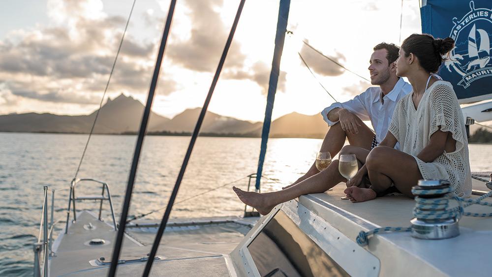 Couple at sunset on a catamaran at Shangri-La's Le Touessrok Mauritius