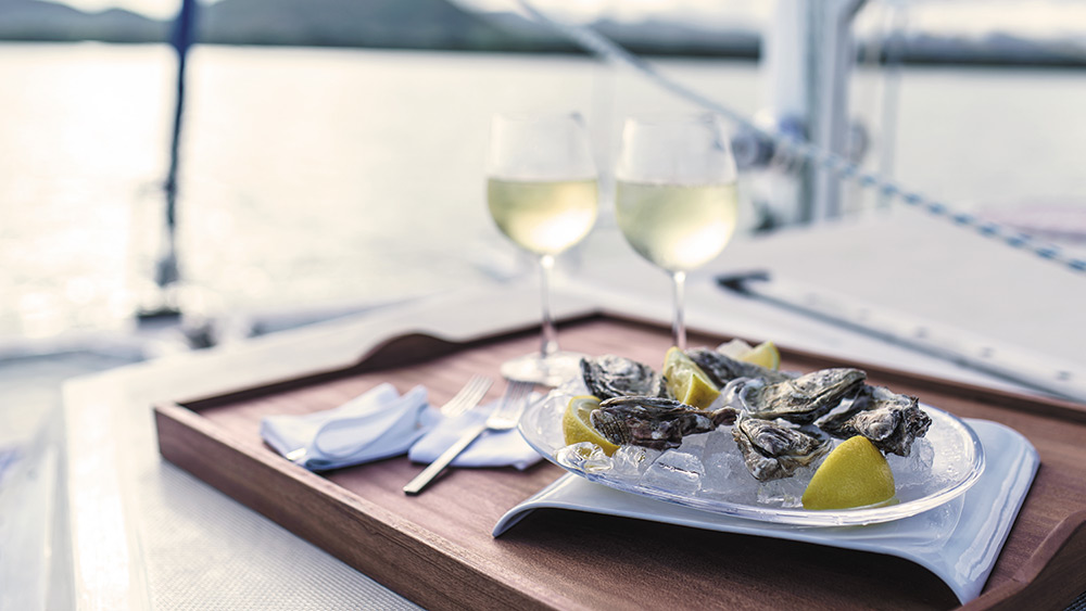 Oysters and wine on a catamaran at Shangri-La's Le Touessrok Mauritius