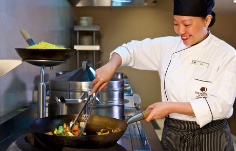 Chef cooking in a wok at Doubletree by Hilton Resort Marjan Island