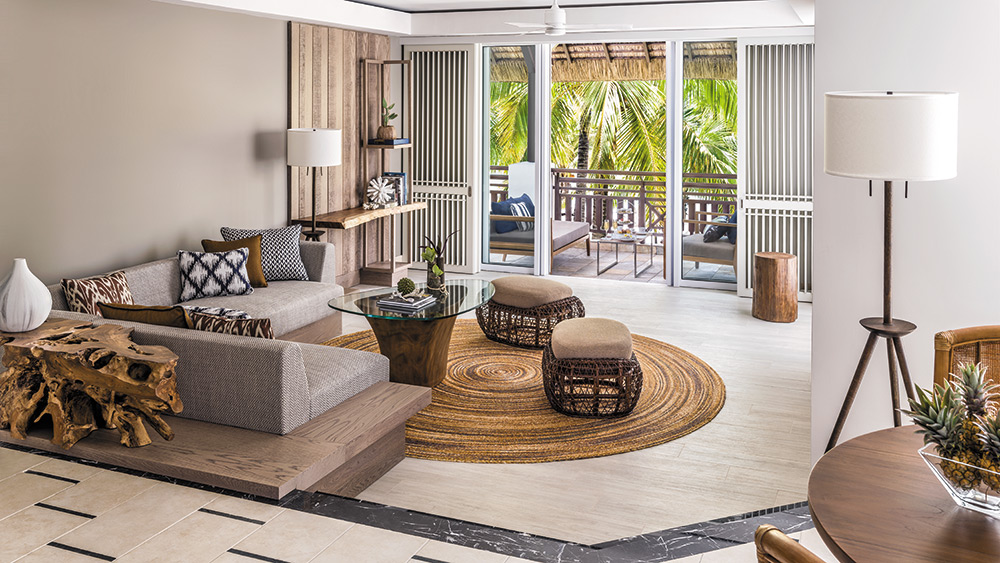 Living room of the Deluxe Frangipani Suite at Shangri-La Le Touessrok