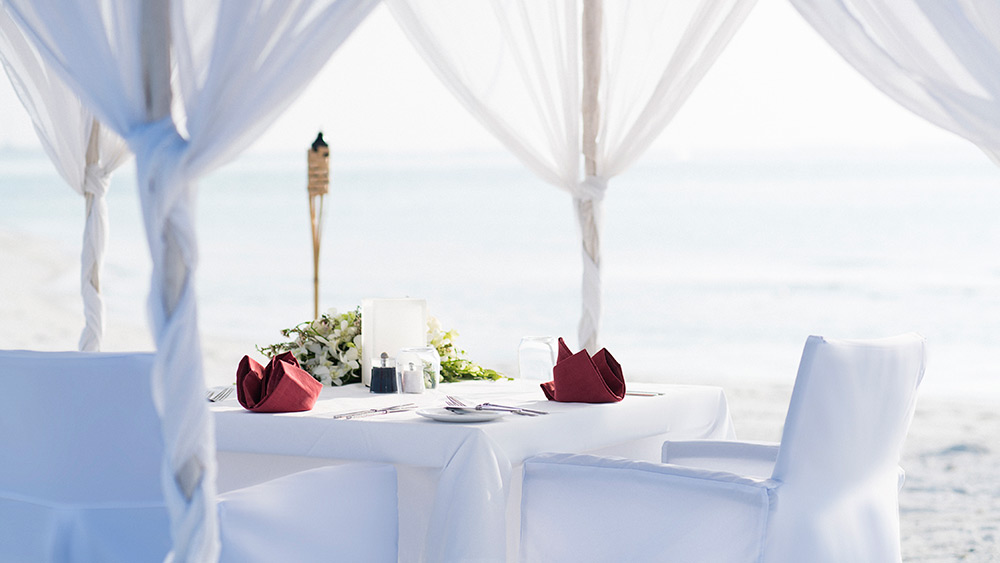Private dining on the beach at Anantara Dhigu Resort