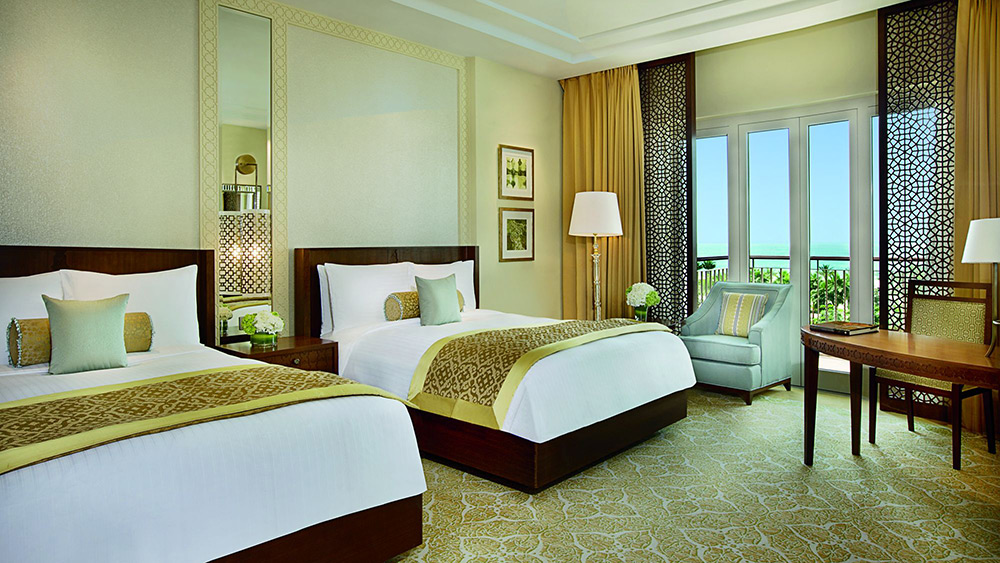 Bedroom with twin beds in the Family Room at Ritz-Carlton Dubai