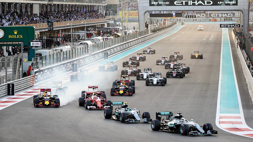 Formula 1 cars into the first corner at the Abu Dhabi Grand Prix