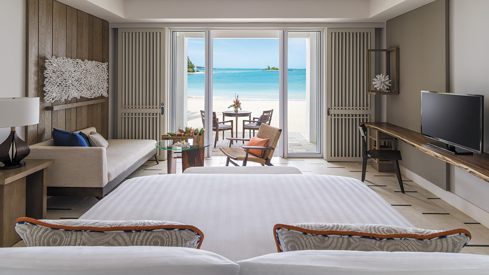 Bedroom of the Junior Suite Hibiscus Beach Access at Shangri-La Le Touessrok