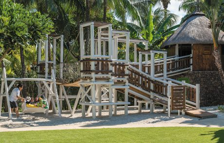 Kids on play equipment in the kids club at Shangri-la Le Touessrok in Mauritius