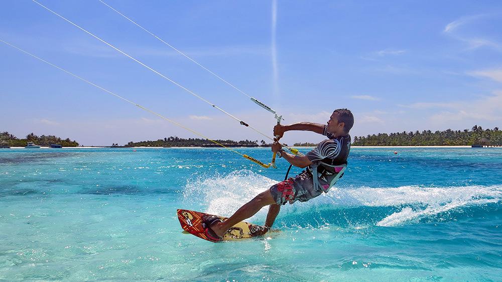 Man kitesurfing at Anantara Dhigu Resort