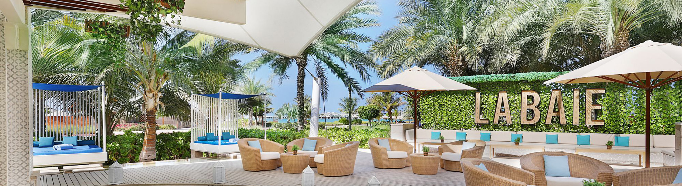 Poolside dining at La Baie at Ritz-Carlton Dubai