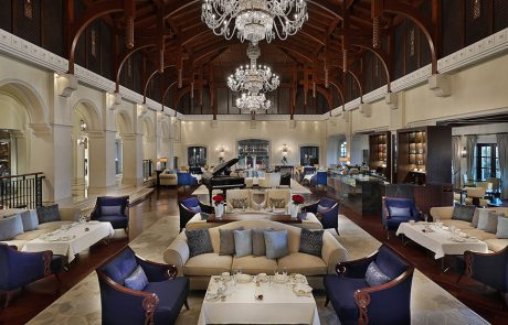 Lounges and chandelier in the Lobby Lounge at Ritz-Carlton Dubai