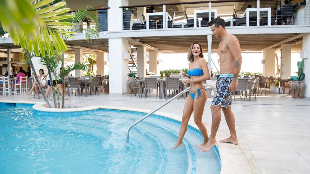 couple entering the main pool at Sugar Bay Barbados